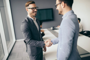 Top franchises business people shaking hands, finishing up meeting